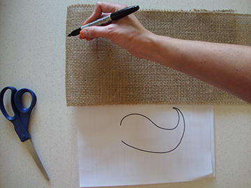 Draw mustache shape on burlap