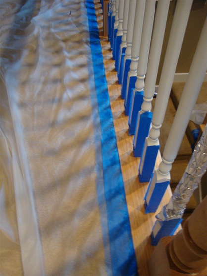 blog-staircase-cover-carpet-with-drop-cloth-taped-down