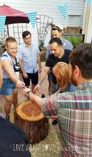 blog-hammerschlagen-game-players-get-nail-to-start-oktoberfest-party