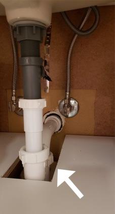 powder-room-vanity-cut-room-for-pipe