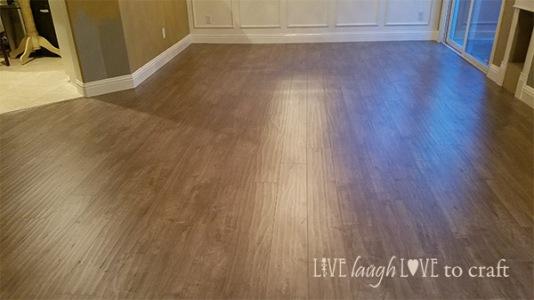 living-room-laminate-flooring-patina-design-pheonix-mint-gray-brown.jpg