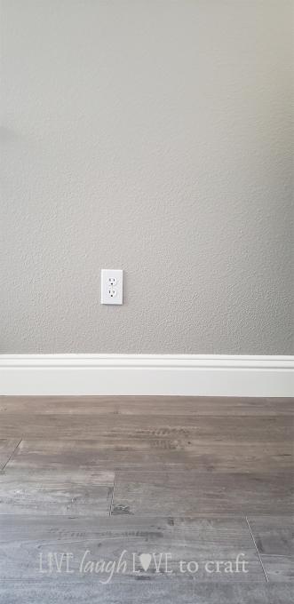living-room-patina-design-phoenix-laminate-mint-valspar-ashen-gray-walls